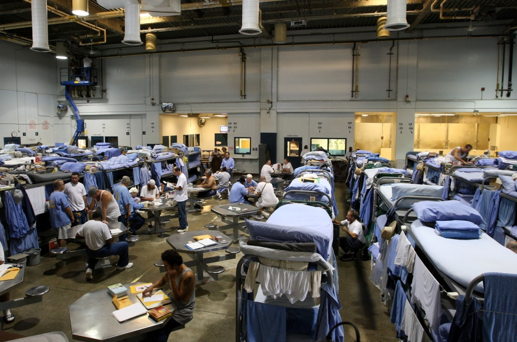 File: Inmates at the Mule Creek State Prison interact in a gymnasium that was modified to house prisoners Aug. 28, 2007 in Ione, California.