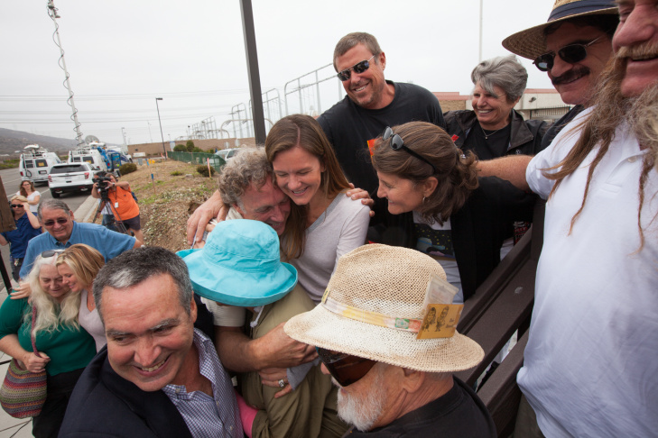 Environmental activists hug at a press conference outside of the San Onofre nuclear plant on June 7th, 2013. Edison announced that the plant will be shut down permanently.