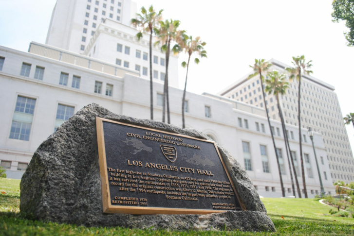 New plantings surround a memorial to Los Angeles firefighters in a corner of the park surrounding City Hall.