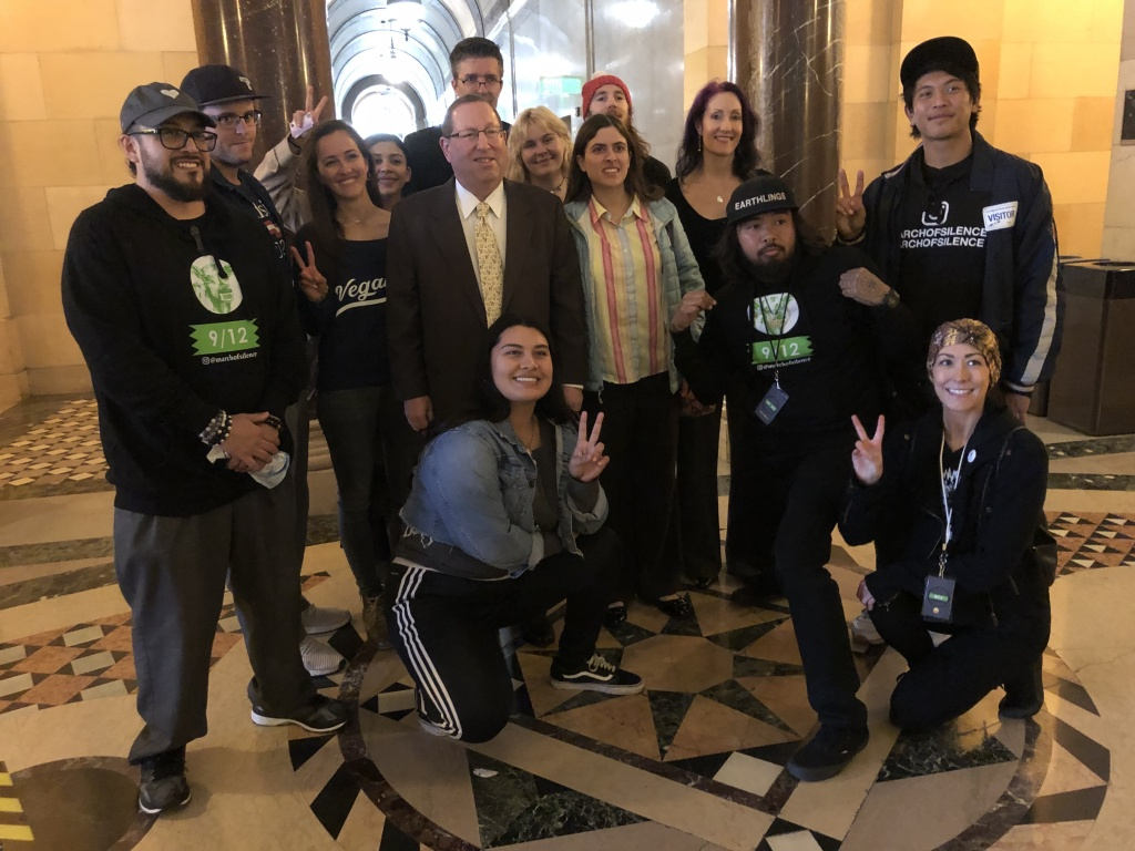 Councilman Paul Koretz stands with vegan activists before introducing a motion in City Council to bring more vegan food to large venues.