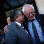 U.S. Sen. Bernie Sanders (R) (I-VT) speaks with AFL-CIO President Richard Trumka (L).