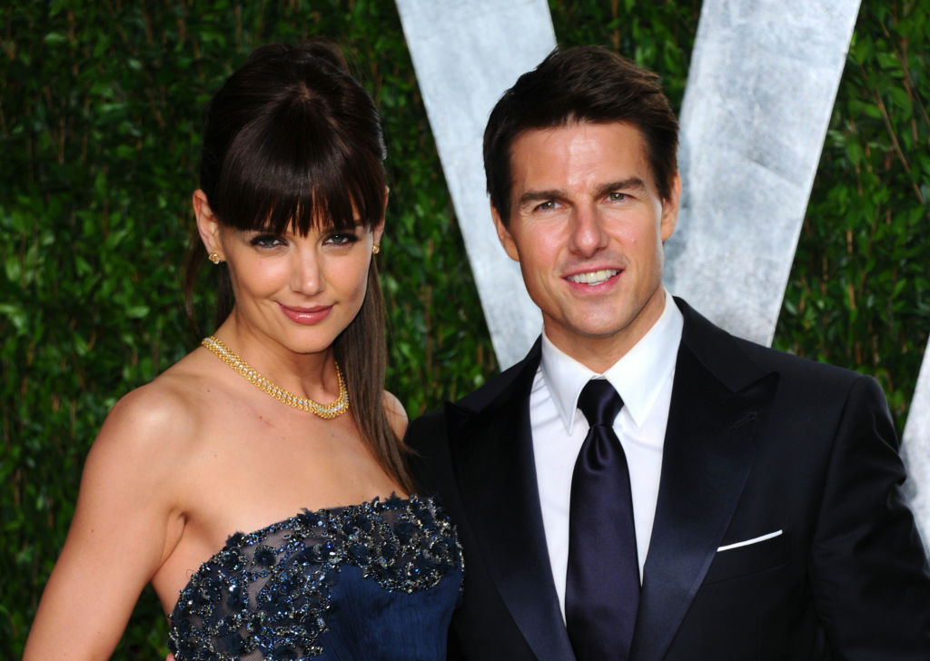 Actress Katie Holmes and actor Tom Cruise arrive at the Vanity Fair Oscar Party hosted by Graydon Carter at Sunset Tower on February 26, 2012 in West Hollywood, California.