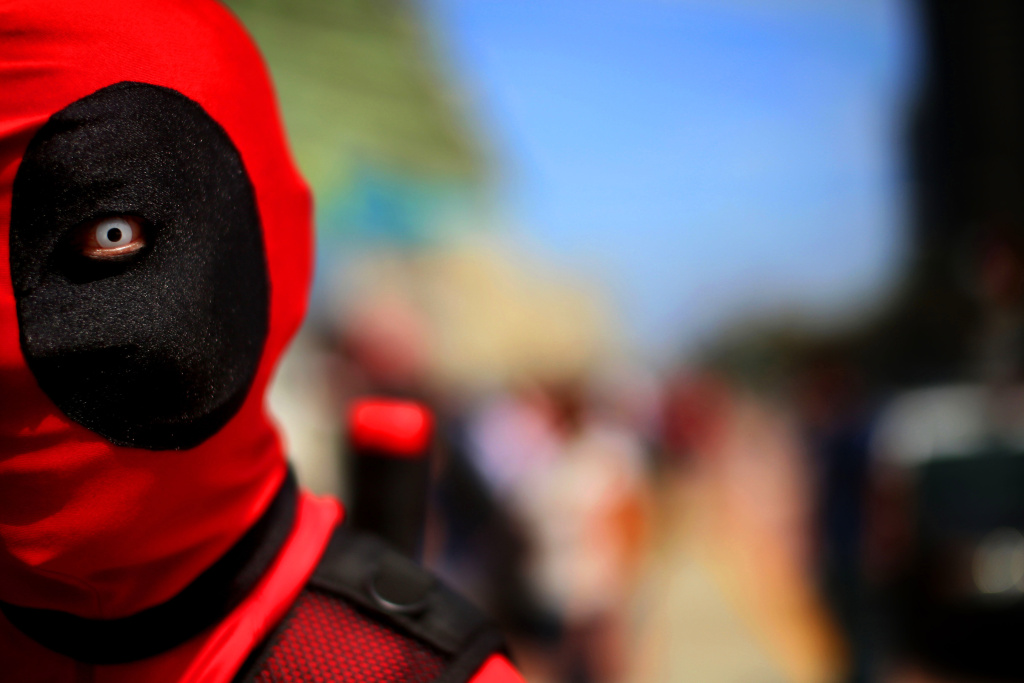 File: Stephen Yan dresses as Deadpool at Comic-Con on July 19, 2013 in San Diego.