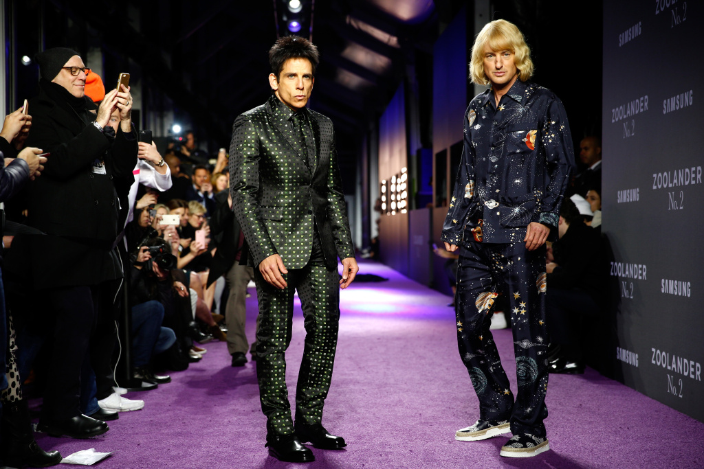Actors Ben Stiller (L) and Owen Wilson walk the runway during the