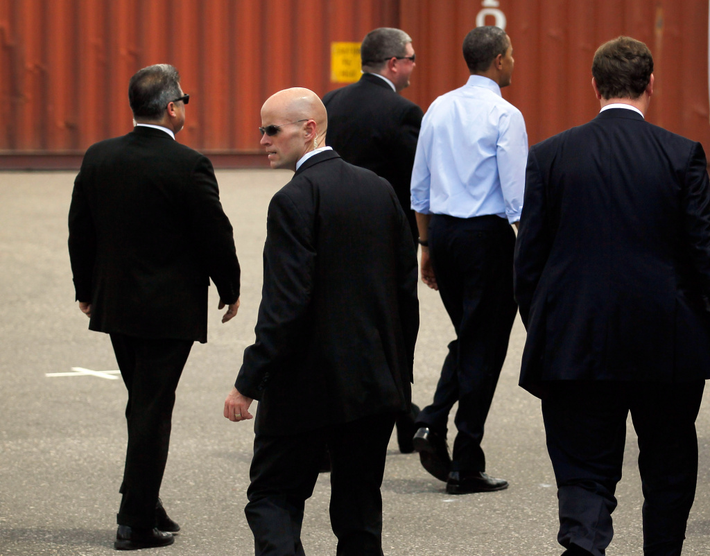 President Barack Obama surrounded by Secret Service agents walks away after a visit to the Port of Tampa on April 13, 2012 in Tampa, Florida. The president, on his way to the Summit of the Americas in Colombia, used the visit to emphasize small business trade with countries in Latin America.
