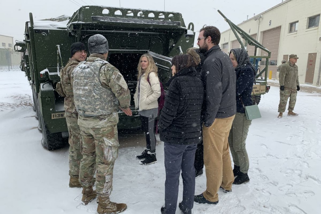 Discover Canyon High School Counselor Staci Wayant (center) joins other Colorado teachers on a tour of military vehicles on Fort Carson.