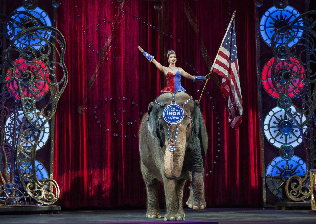 A performer rides an elephant holding a US national flag during a Ringling Bros. and Barnum & Bailey Circus performance in Washington, DC on March 19, 2015.