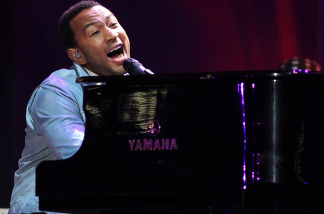 John Legend performs a the piano during the kick-off celebration concert for the 2010 FIFA World Cup at the Orlando Stadium on June 10, 2010 in Soweto, South Africa.