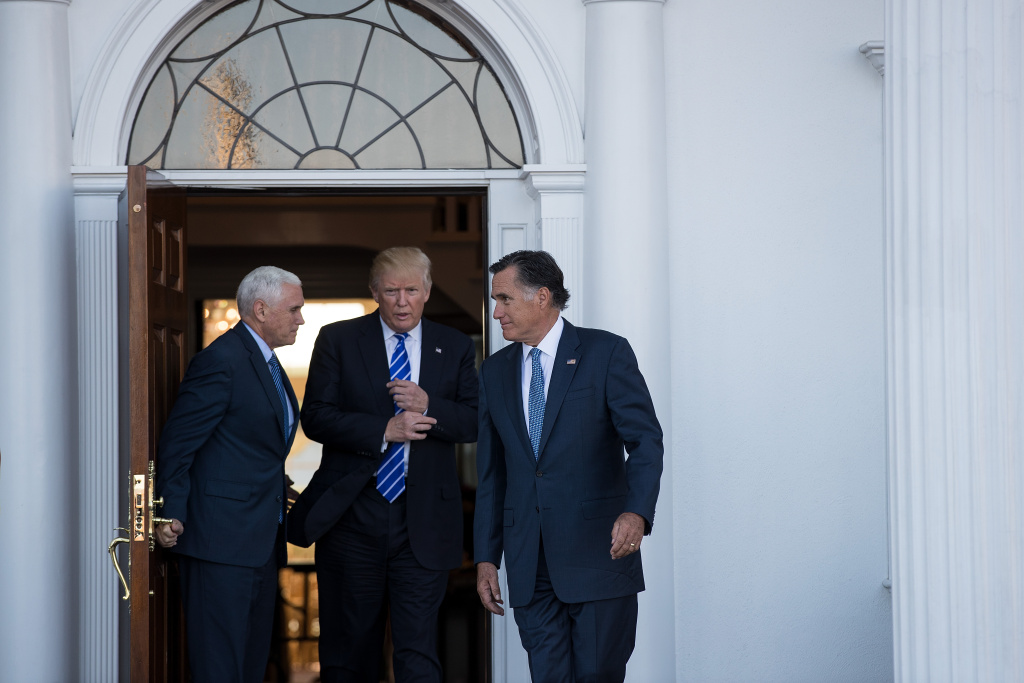 (L to R) Vice president-elect Mike Pence, President-elect Donald Trump and Mitt Romney leave the clubhouse after their meeting at Trump International Golf Club, November 19, 2016.