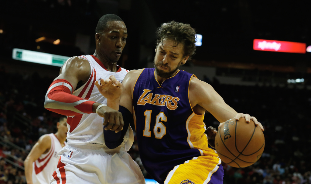 Pau Gasol #16 of the Los Angeles Lakers works the ball against Dwight Howard #12 of the Houston Rockets during the game at the Toyota Center on January 8, 2014 in Houston, Texas.