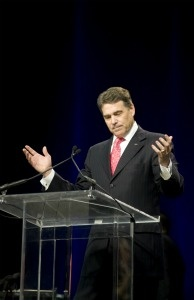 Texas Governor Rick Perry speaks to an estimated 30,000 attendees at the non-denominational prayer and fasting event, 'The Response,' on August 6, 2011 in Houston, Texas.