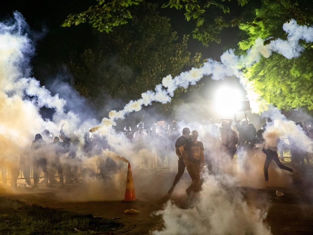 Tear gas rises as protesters face off with police during a demonstration on May 31 outside the White House over the death of George Floyd at the hands of Minneapolis Police.
