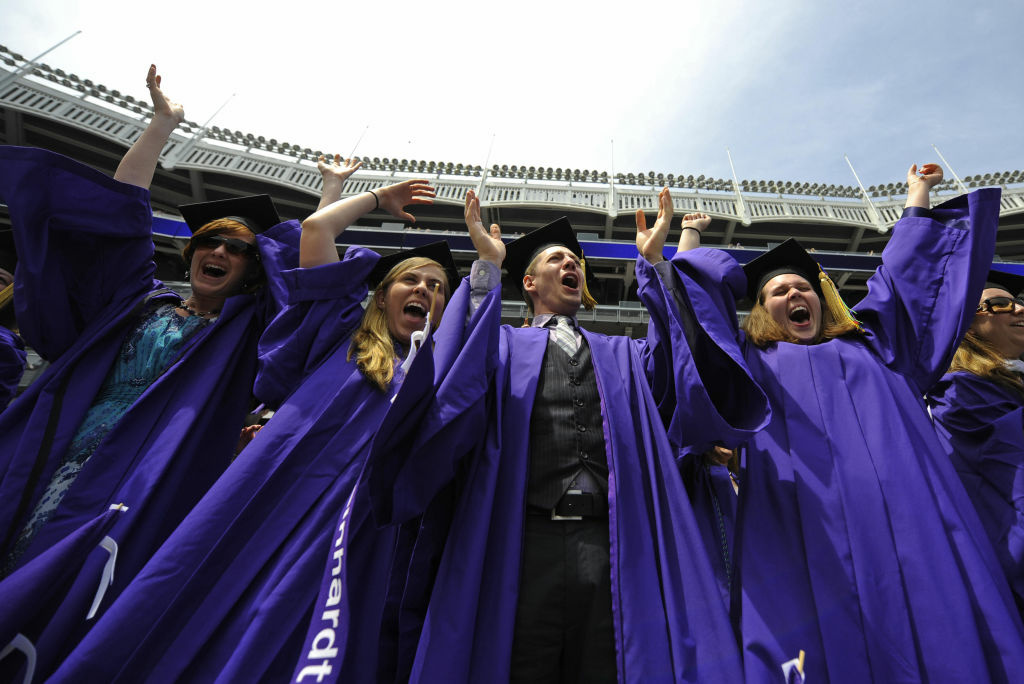New York University (NYU) students cheer after receiving their degrees at their graduation ceremony.