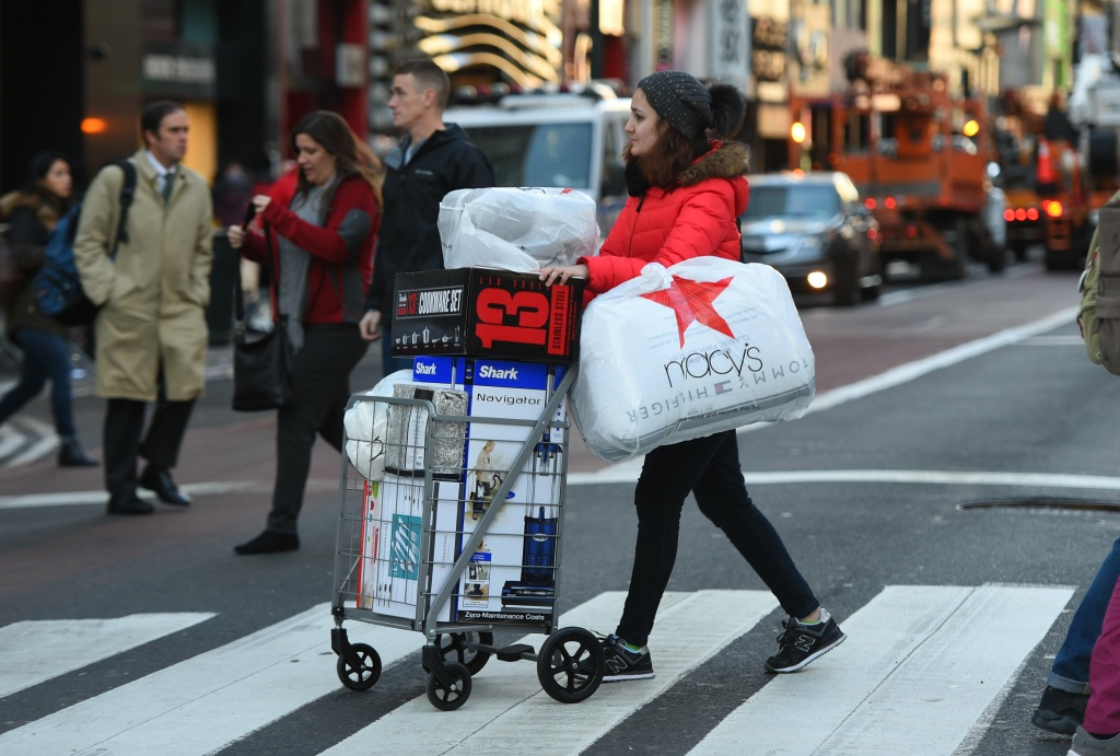 A shopper takes advantage of the Black Friday sales the day after Thanksgiving in New York City November 24, 2017.