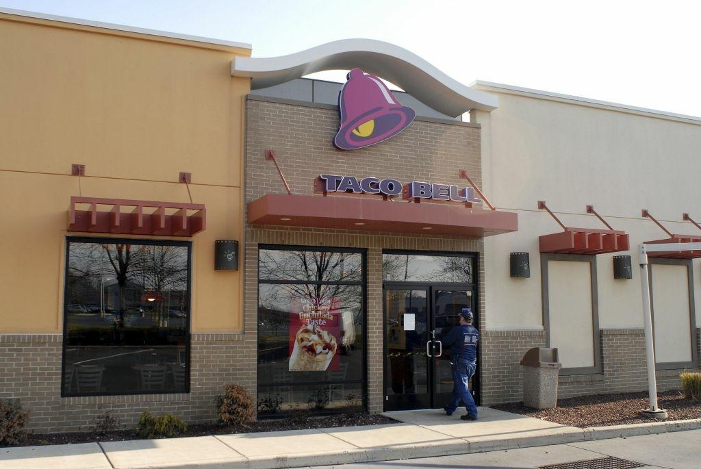 A man enters a closed Taco Bell restaurant at Franklin Mills Mall December 7, 2006 in Philadelphia, Pennsylvania.