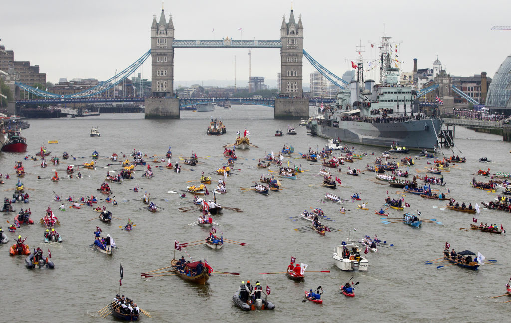 Hundreds of boats make their way down the River Thames past for British Royal Navy cruiser HMS Belfast towards Tower Bridge as they take part in the Thames River Pageant for the Queen's Diamond Jubilee celebrations in London,Sunday, June 3, 2012. More than 1,000 boats were to sail down the Thames on Sunday in a flotilla tribute to Queen Elizabeth II's 60 years on the throne that organizers are calling the biggest gathering on the river for 350 years. Despite cool, drizzly weather, hundreds of thousands of people are expected to line the riverbanks in London, feting the British monarch whose longevity has given her the status of the nation's favourite grandmother.