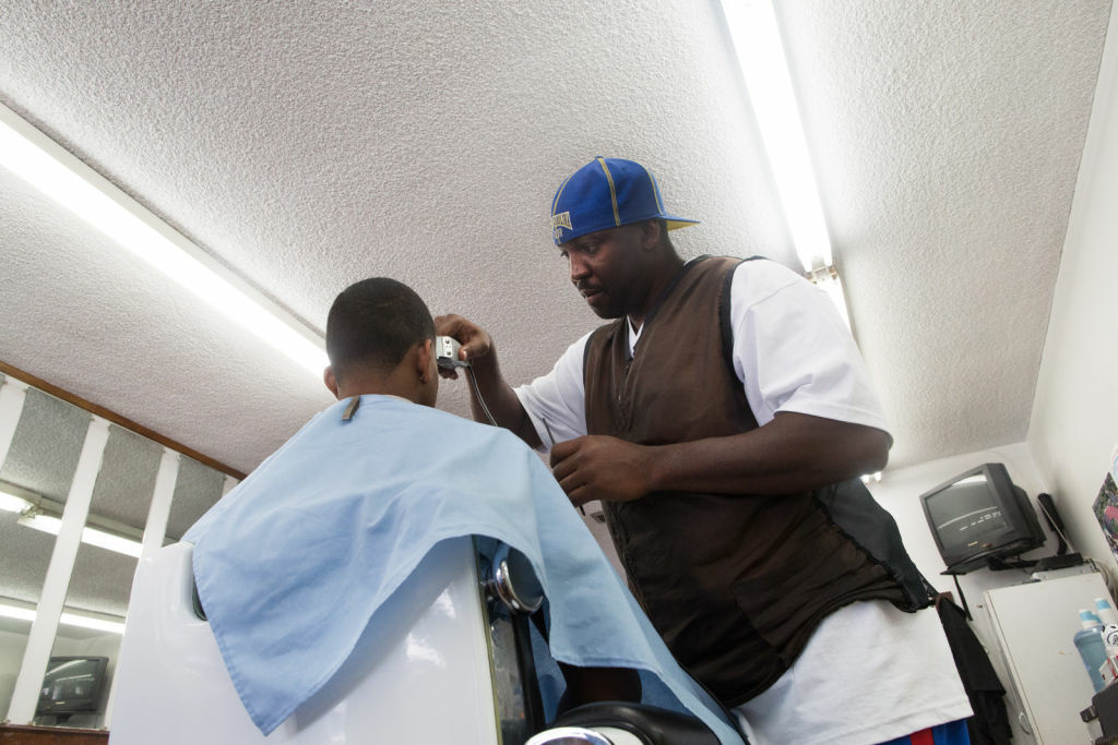 Brian Micheall cuts Justin Smith's hair at the 40-year-old Steppe's Barber Shoppe in Altadena, Calif. Micheall is excited for the Walmart Neighborhood Market because he thinks it could help revitalize the neighborhood.