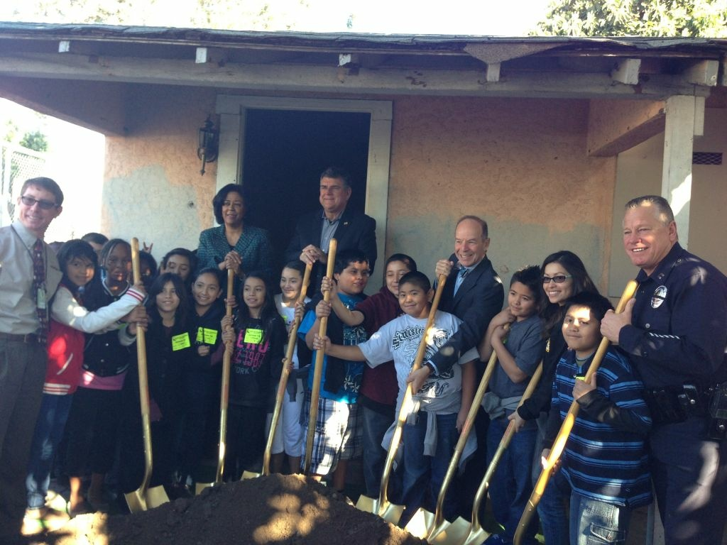 Jan Perry along with neighborhood children break ground on Wall Street Park in South L.A.