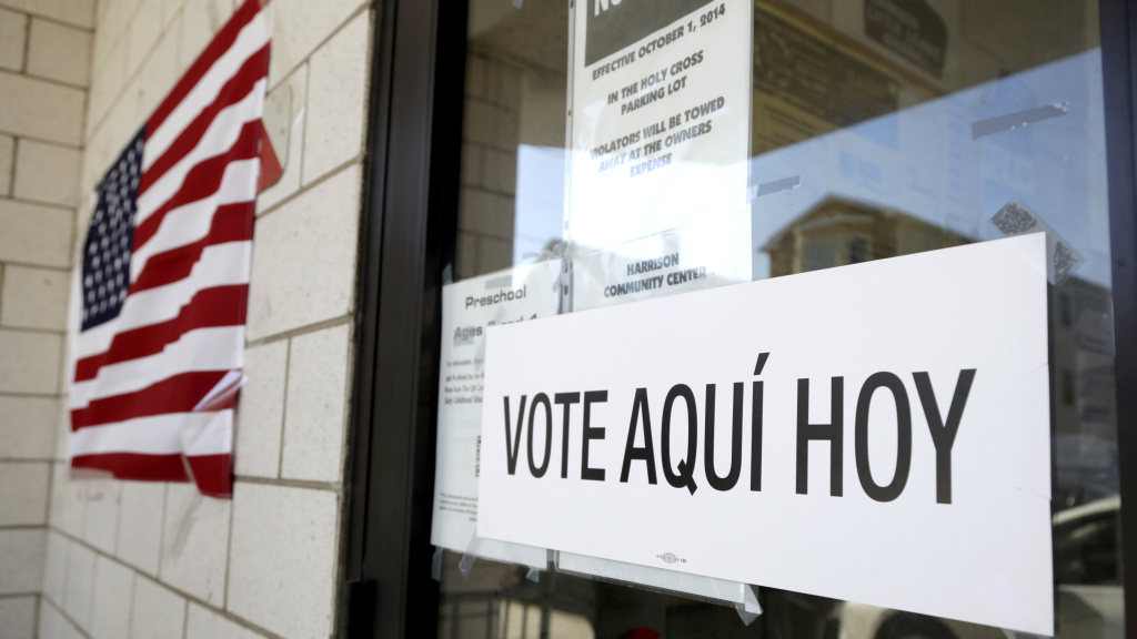A sign announces a polling place in Spanish outside the Harrison Community Center during New Jersey's primary election June 5.