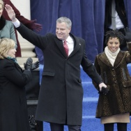 New York City Mayor Bill de Blasio, left, arrives with his family Chiara de Blasio, second from left, Dante de Blasio, center, right, and Chirlane McCray to take the oath of office in on the steps of City Hall on Jan. 1.