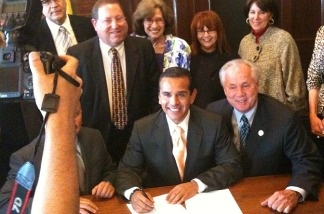 Los Angeles mayor Antonio Villaraigosa signs the so-called Hillside Mansionization Ordinance on April 6, 2011, at City Hall.