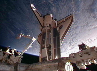 Image above: Space shuttle Discovery docked to pressurized mating adapter #2 on the International Space Station's Harmony node.
