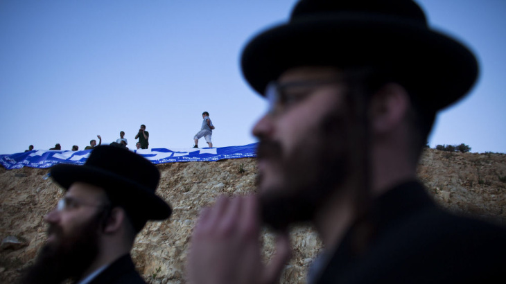 Israelis who support Jewish settlements in the West Bank rally against a demolition order for the outpost of Ulpana on Sunday. Israeli courts have ordered the outpost torn down, but Prime Minister Benjamin Netanyahu's government is looking to keep it intact.