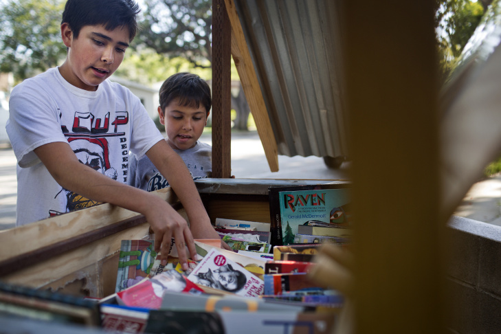 Twelve-year-old Luke Quezada, a seventh grader at South Pasadena Middle School, built a book swap stand outside his family's South Pasadena home.