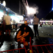 LAS VEGAS, NV - OCTOBER 01:  People take cover at the Route 91 Harvest country music festival after apparent gun fire was heard on October 1, 2017 in Las Vegas, Nevada.  There are reports of an active shooter around the Mandalay Bay Resort and Casino.  (Photo by David Becker/Getty Images)