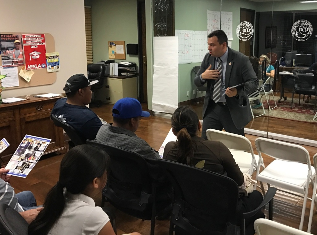Hugo Salazar from the Orange County Labor Federation gives a know your rights talk to immigrants waiting to sign power of attorney documents in case they are detained or deported.