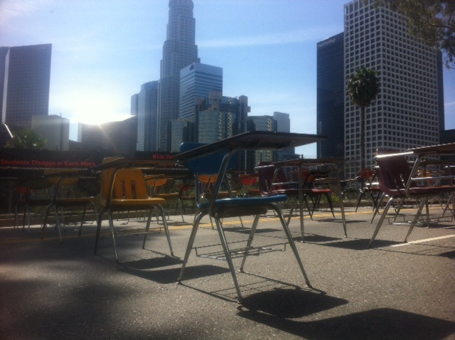 Desks placed outside of L.A. Unified headquarters a head of April board meeting. Advocacy groups wants more money to high needs schools in effort to increase academic performance and graduation rates.