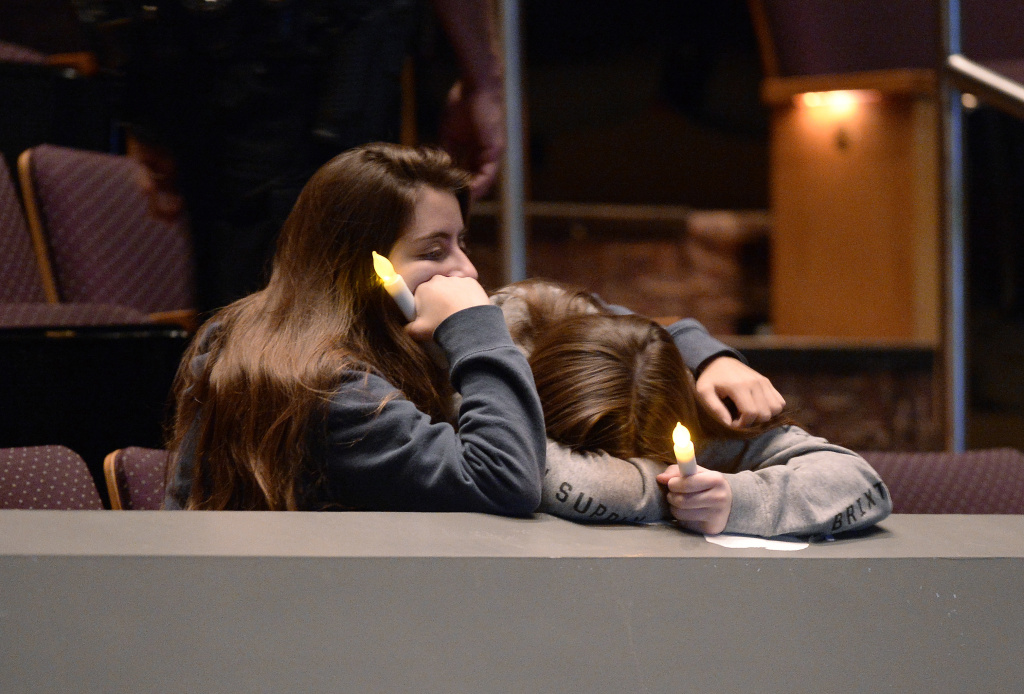 Mourners comfort each other Thursday during a vigil at the Thousand Oaks Civic Arts Plaza for the victims of the mass shooting at Borderline Bar and Grill in Thousand Oaks, Calif.