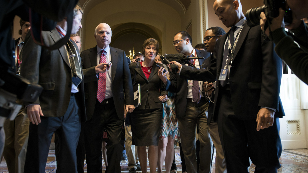 Sens. John McCain, R-Ariz., Susan Collins, R-Maine, in a 2013 file photo. They along with Sen. Rand Paul, R-Ky., have announced firm opposition to the latest GOP health care bill.