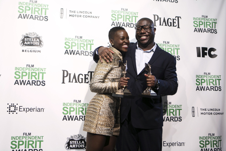 Lupita Nyongo holds her award for best supporting actress and director Steve McQueen holds his award for best director for 12 Years a Slave at the 2014 Independent Spirit Awards on March 1, 2014 in Santa Monica.