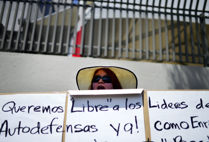 Lucy Sanchez demonstrates in front of the Mexican consulate in Los Angeles Thursday. Sanchez's cousin was recently arrested by police in Michoacan State in Mexico.