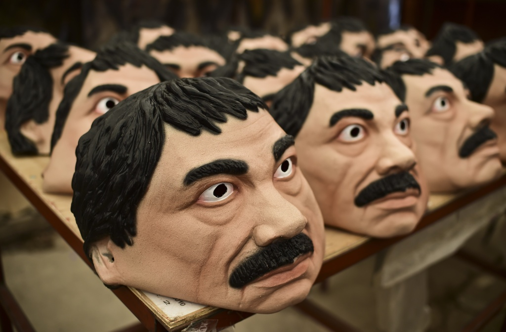 Boo! It's that time of year again! Masks of the Mexican drug trafficker Joaquin Guzman Loera a.k.a