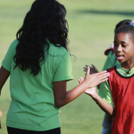 ylen Williams congratulates children after playing soccer at the Nickelodeon Celebrates The Road To Worldwide Day Of Play In San Diego With The Pro Kids: First Tee Of San Diego on July 1, 2014.