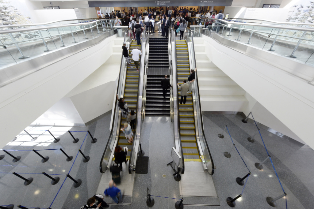 Travelers approach the security screening after Terminal 3 was re-opened a day after a shooting at Los Angeles International Airport November 2, 2013.