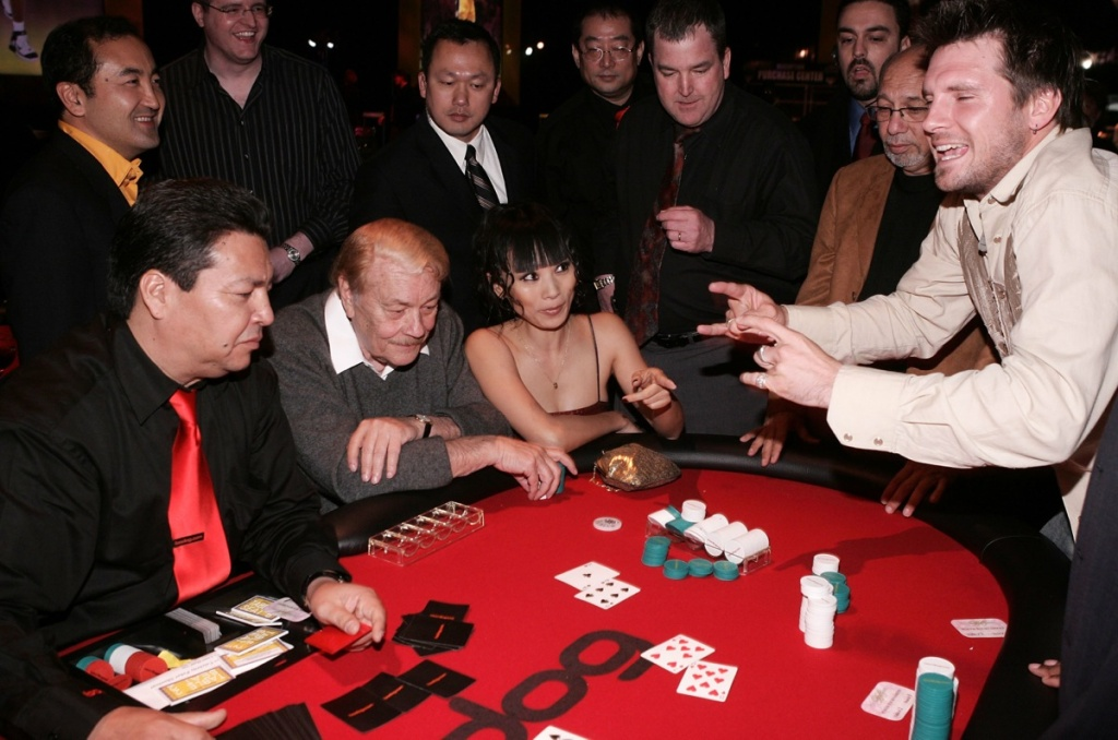 Dr. Jerry Buss, actress Bai Ling and television personality Rossi Morreale play poker at the Los Angeles Lakers 3rd annual Mirage Las Vegas Casino Night and Bodog Celebrity Poker Invitational benefiting Los Angeles Lakers Youth Foundation at Barker Hangar on April 12, 2006 in Santa Monica.
