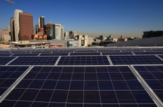 Solar panels cover the rooftop of the Staples Center sports complex in Los Angeles, California.