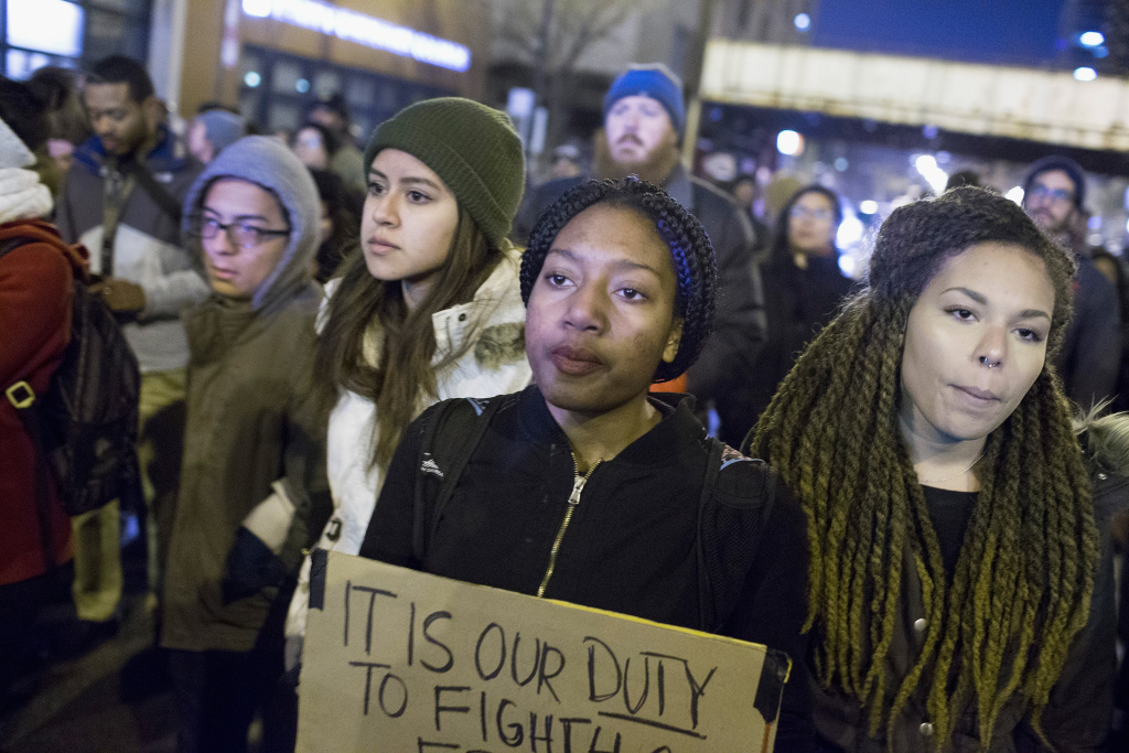 CHICAGO, IL - NOVEMBER 24:  Demonstrators march through downtown following the release of a video showing Chicago Police officer Jason Van Dyke shooting and killing Laquan McDonald on November 24, 2015 in Chicago, Illinois. Van Dyke was charged today with first degree murder for the October 20, 2014 shooting in which McDonald was hit with 16 bullets.  (Photo by Scott Olson/Getty Images)