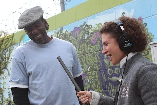 Alex Cohen interviews Ron Finley right next to his sidewalk garden.