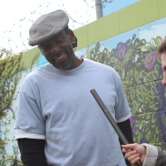 Alex Cohen interviews Ron Finley right next to his sidewalk garden.