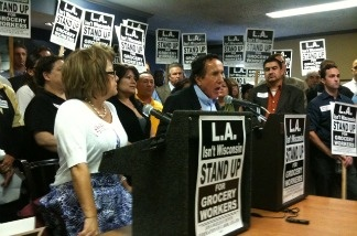 Maria Elena Durazo of the Los Angeles County Federation of Labor, and Rick Icaza of United Food and Commercial Workers, speak at a gathering of labor leaders on June 8, 2011 to rally in advance of a possible strike by grocery workers.