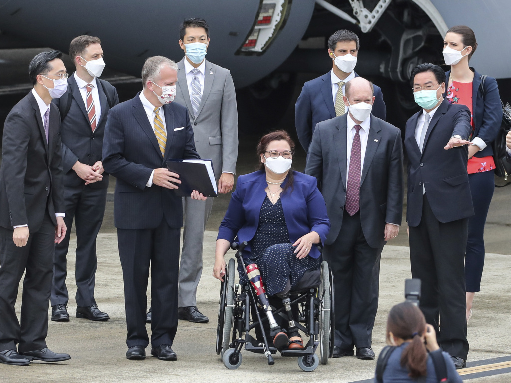 Taiwan's Foreign Minister Joseph Wu, second right, welcomes U.S. senators to his right Democratic Sen. Christopher Coons of Delaware, a member of the Foreign Relations Committee, Democratic Sen. Tammy Duckworth of Illinois and Republican Sen. Dan Sullivan of Alaska, members of the Armed Services Committee on their arrival at the Songshan Airport in Taipei, Taiwan on Sunday, June 6, 2021.