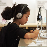 A girl listens to a new iPod on display at the Apple Store July 14, 2005 in San Francisco, California.