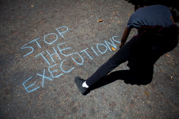 A protester writes a message for the Orange County Police during a demonstration to show outrage for the several recent officer involved shootings on July 29, 2012 in Anaheim, California.