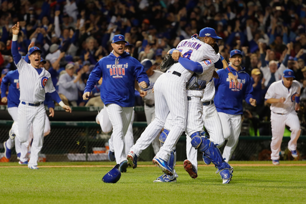 CHICAGO, IL - OCTOBER 22:  Aroldis Chapman #54 celebrates with Willson Contreras #40 of the Chicago Cubs after defeating the Los Angeles Dodgers 5-0 in game six of the National League Championship Series to advance to the World Series against the Cleveland Indians at Wrigley Field on October 22, 2016 in Chicago, Illinois.  (Photo by Jamie Squire/Getty Images)