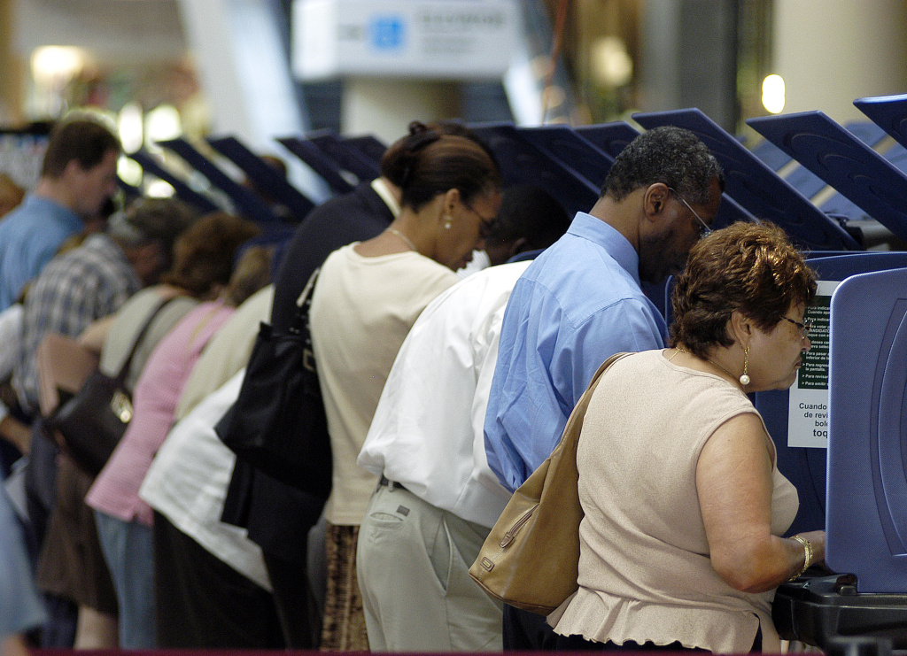 Hispanic voters go to the polls for early voting at the Miami-Dade Government Center on October 21, 2004 in Miami, Florida.