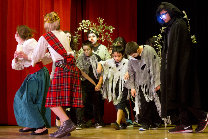 Stage crew members follow the script as their performance starts at Eagle Rock Elementary School. The Macbeth spin-off production was co-directed by their drama teacher and classroom teacher using a teaching method known as arts integration.